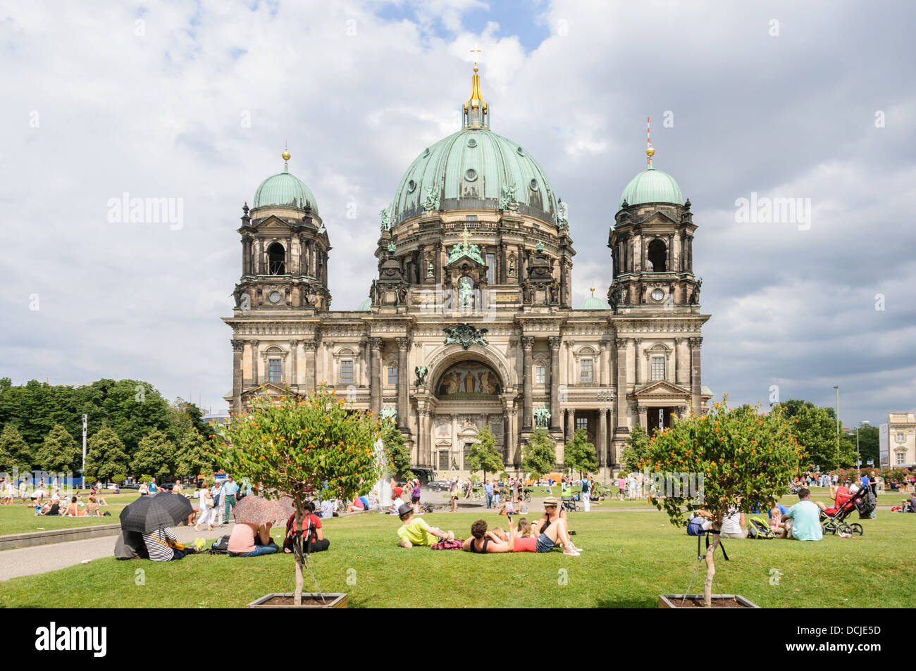 Young people and tourist enjoying summer in the city at the Berlin Cathedral - Berliner Dom - Berlin Germany Stock Photo