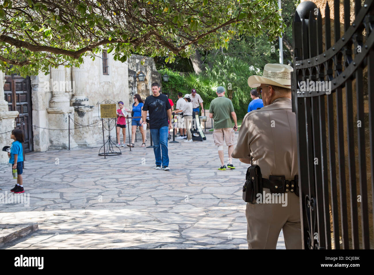 A guard watches visitors to the Alamo - Stock Image