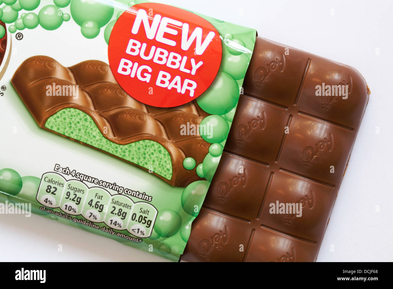 Nestle Mint aero new bubbly big bar of chocolate with contents showing outside of wrapper set on white background - Stock Image