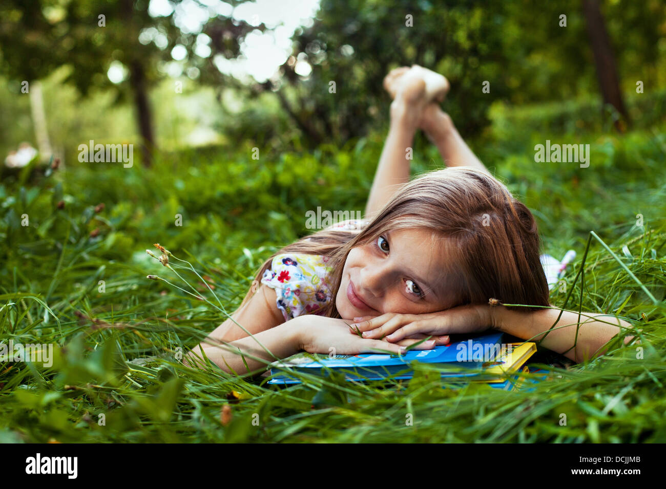 school girl with the books outdoor - Stock Image
