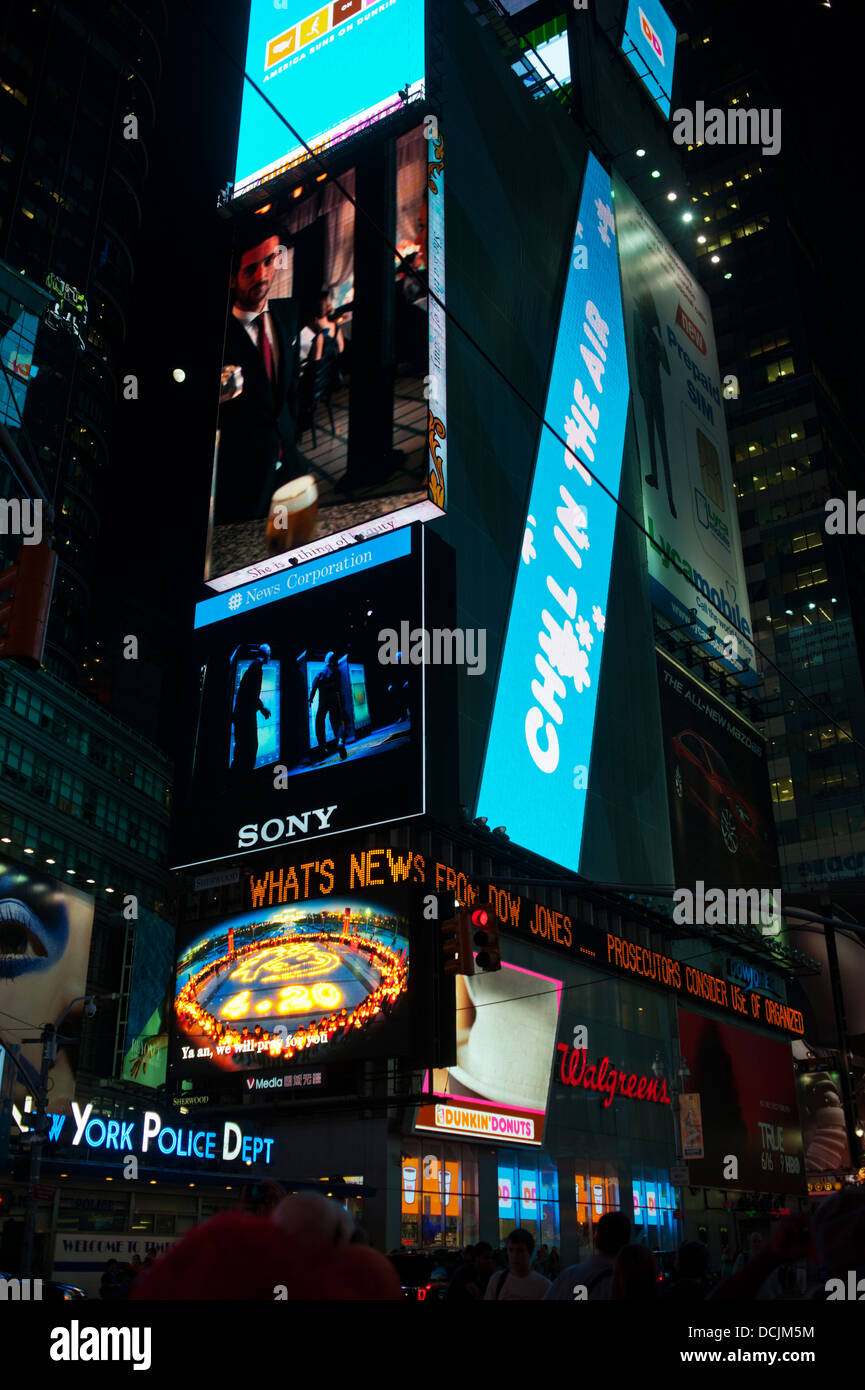 Times Square Lighted Billboards at night New York City - Stock Image