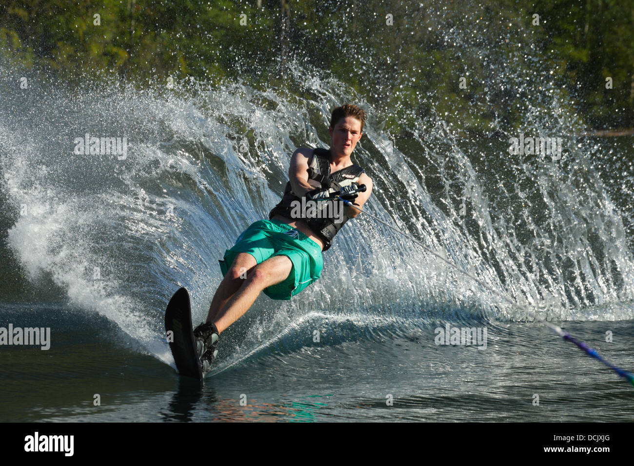 Teenage boy wakeboarding on Cultus Lake-Cultus Lake, British Columbia, Canada. - Stock Image