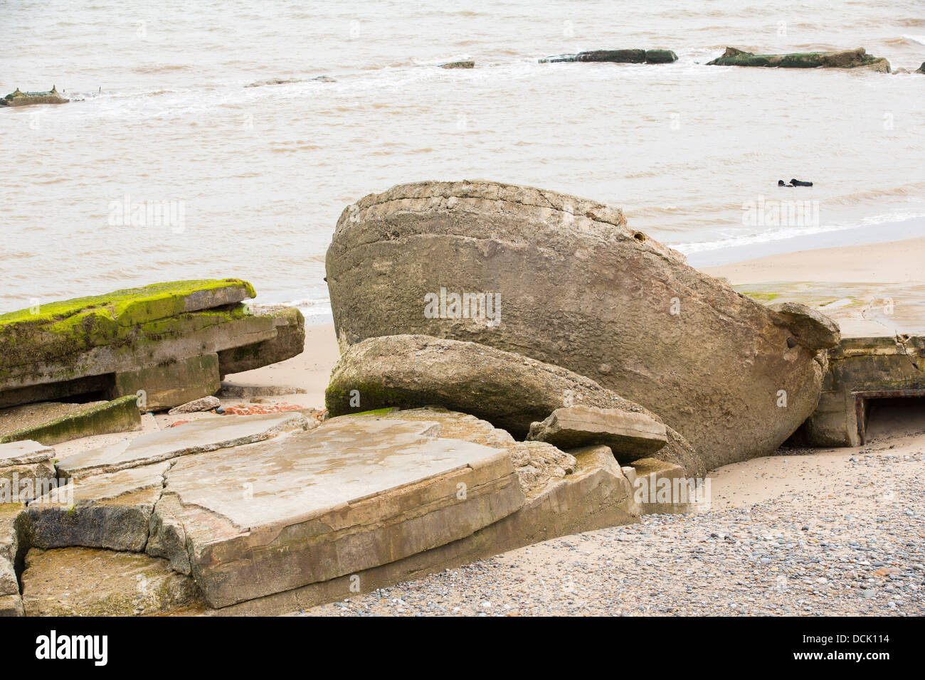 The Remains of a gun emplacement at the Godwin battery on the beach at Kilnsea at the head of Spurn point - Stock Image
