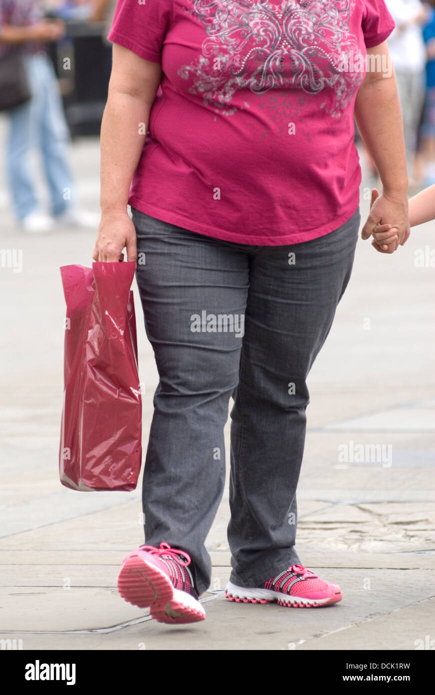 Overweight Fat Obese Mother Holding Daughters Hand London Uk Homer Sykes Stock Image