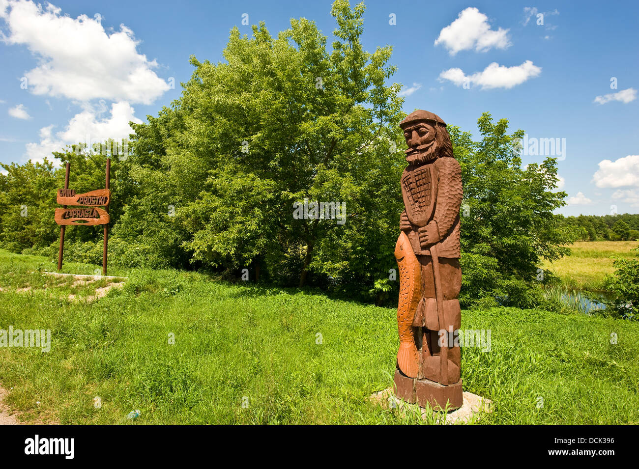 Wooden sculpture of a fisherman in a village in north-eastern part of Poland. - Stock Image