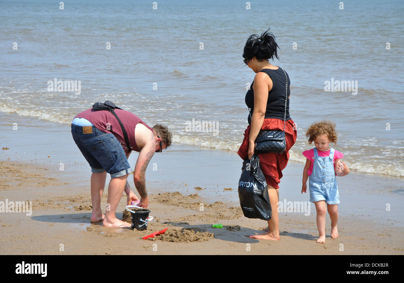family on beach, Skegness, Lincolnshire, England, UK - Stock Image