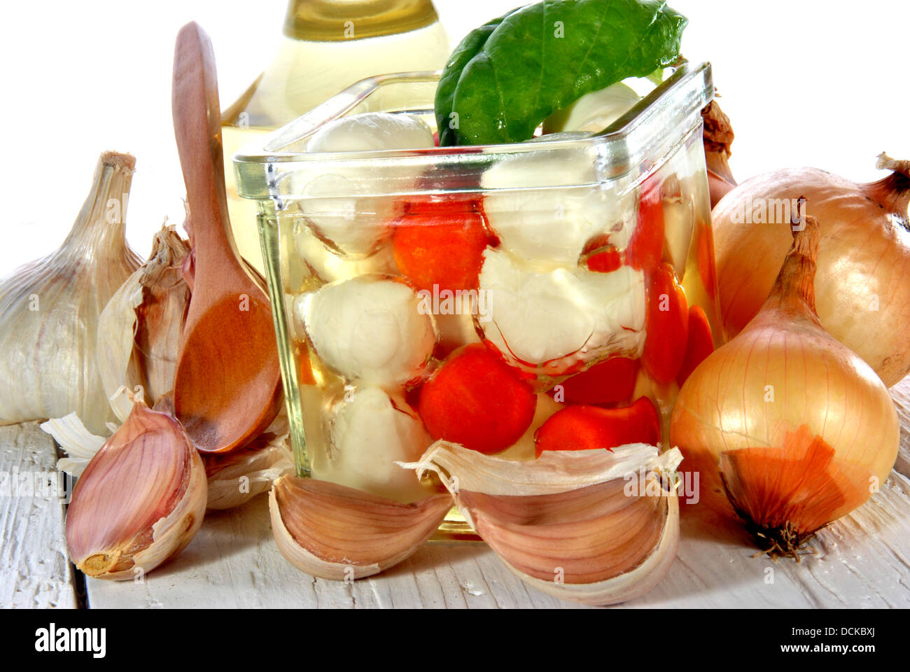 Mozzarella with cherry tomatoes in a jar with oil - Stock Image