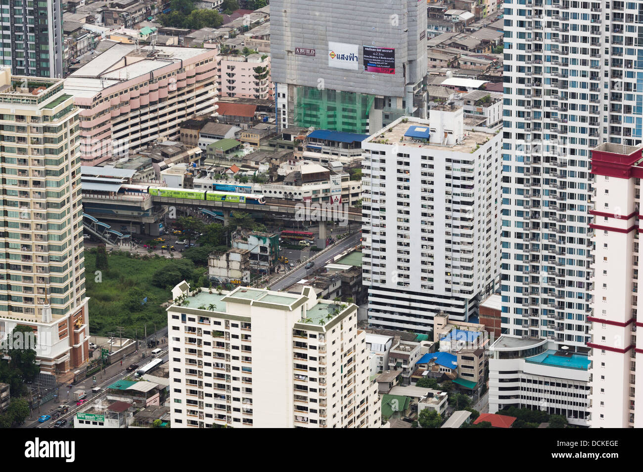 A view of central Bangkok, the capital city of Thailand, with the skytrain (BTS) and many residential towers (condo) - Stock Image