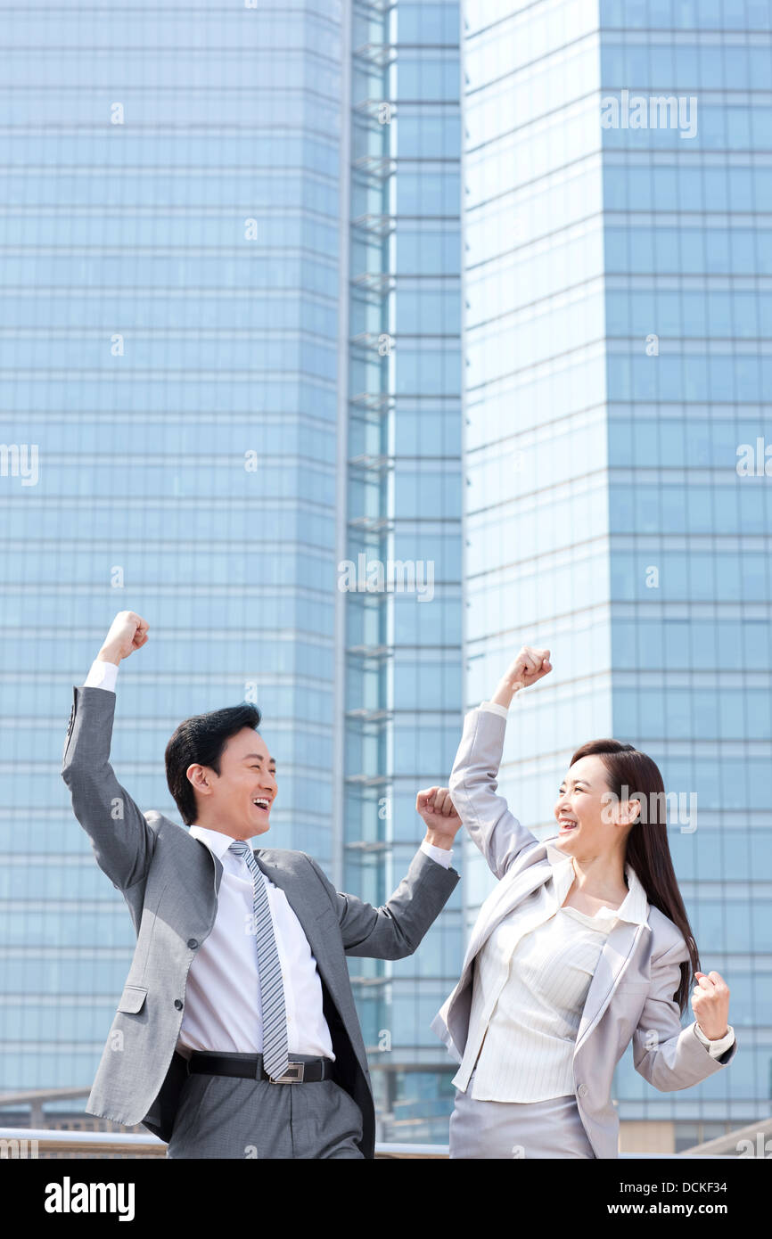 Excited business partners punching the air - Stock Image