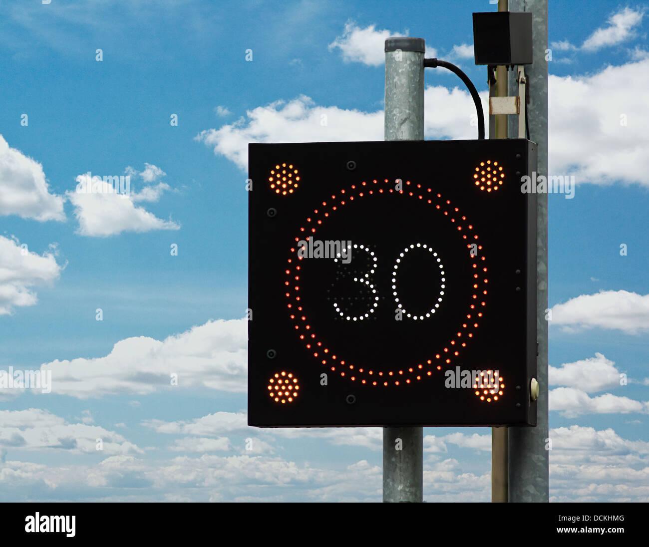 Traffic calming signal flashing 30 - Stock Image
