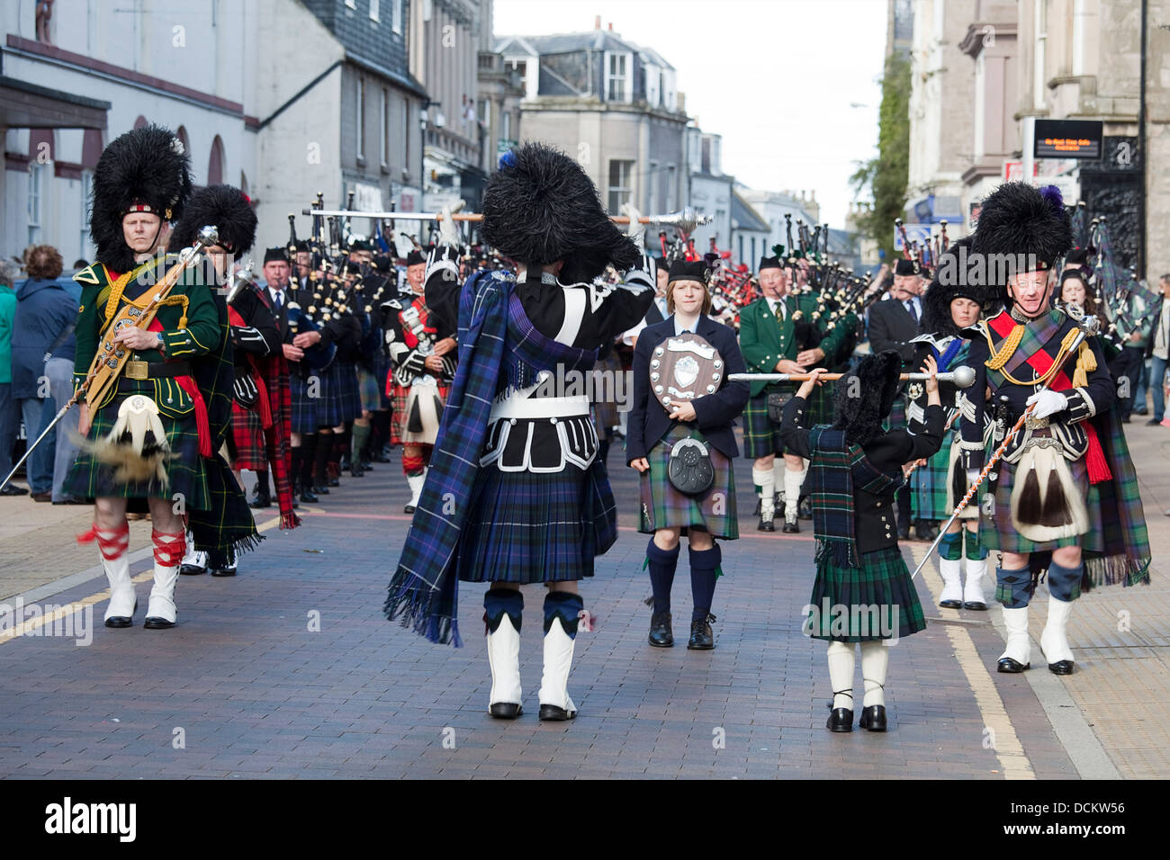 Nairn, Scotland - August 17th, 2013: Drum Majors leading their marching bands through the high street in Nairn. - Stock Image
