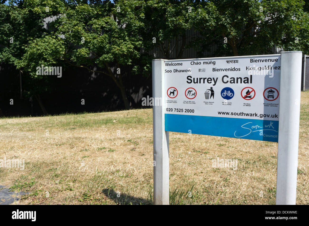 A multilingual sign for the Surrey Canal Linear Park at Peckham in south London. - Stock Image