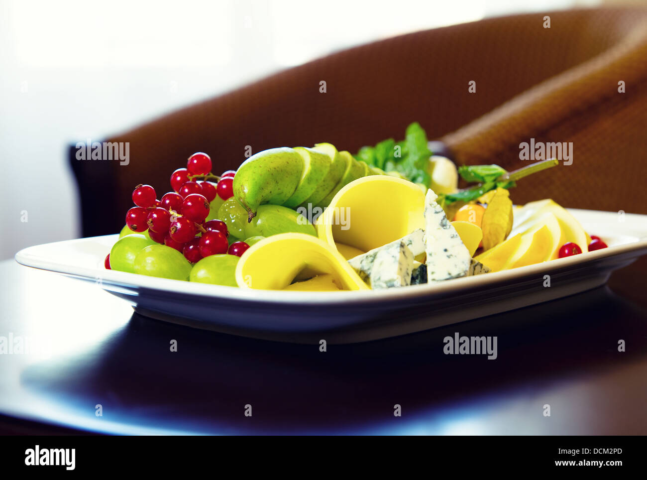 Cheese and fruits - Stock Image
