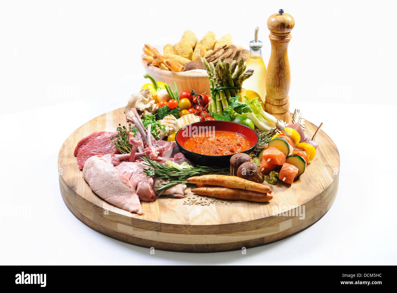 Raw food on a wooden board Stock Photo