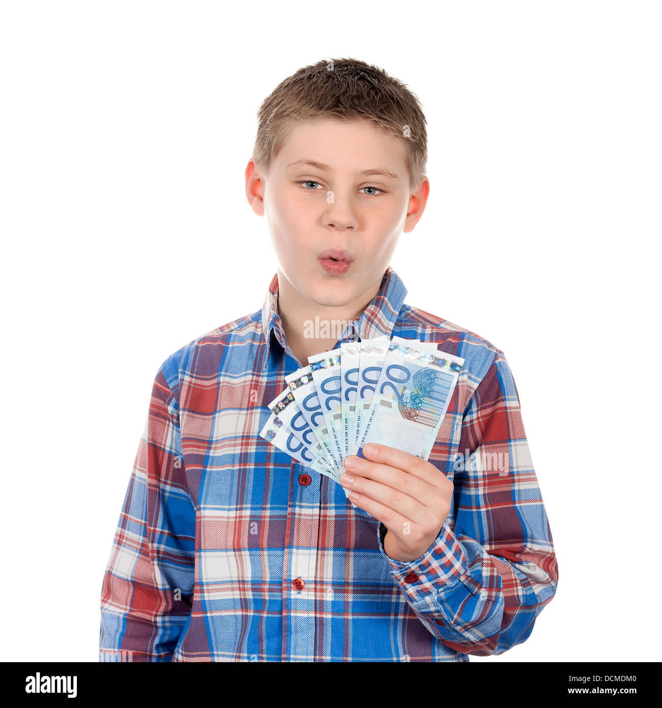 Cute boy with euro notes on white background - Stock Image