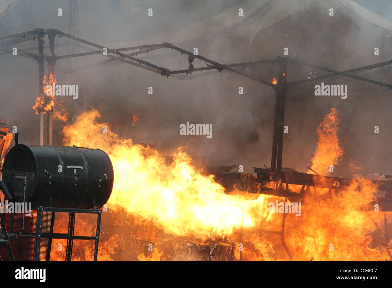Raging uncontrolled fire that has gutted several marquees selling food and other items at a community event in North - Stock Image