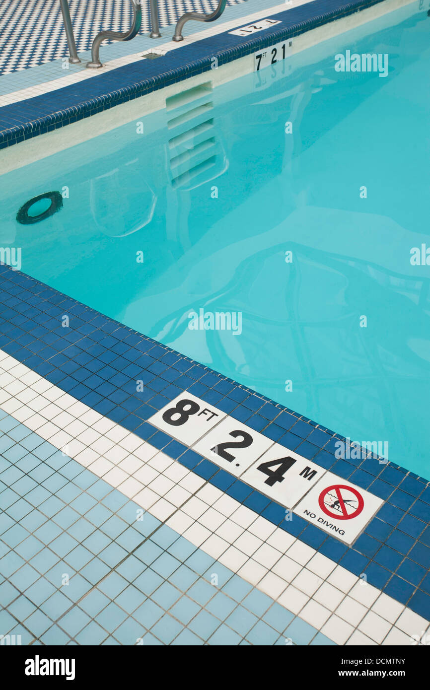 Swimming pool tiles give depth in feet and meters plus a warning not stock photo 59465447 alamy for How many meters is a swimming pool
