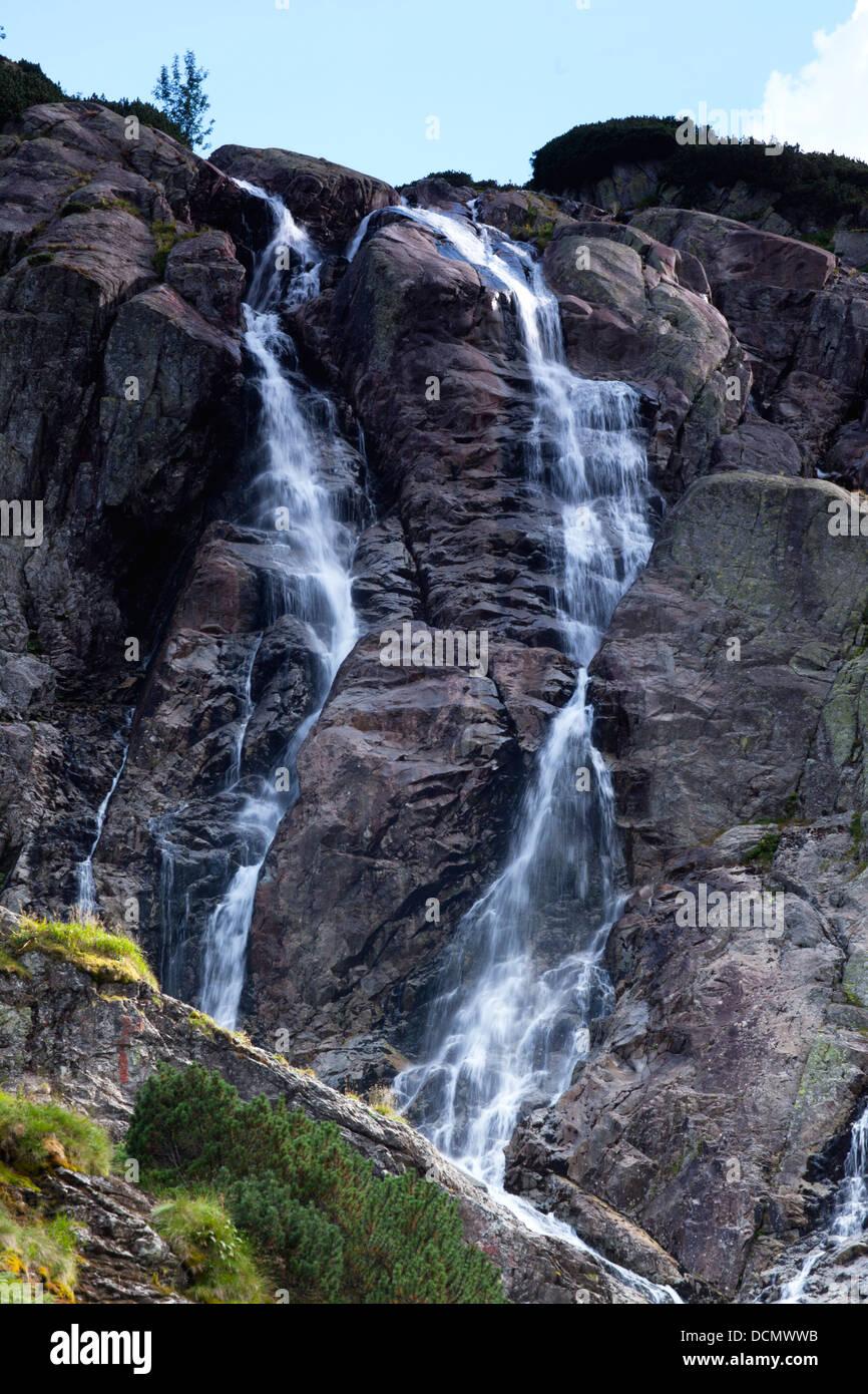 beautiful landscape of mountain waterfall or Siklawa Waterfall in Tatra Mountains - Stock Image
