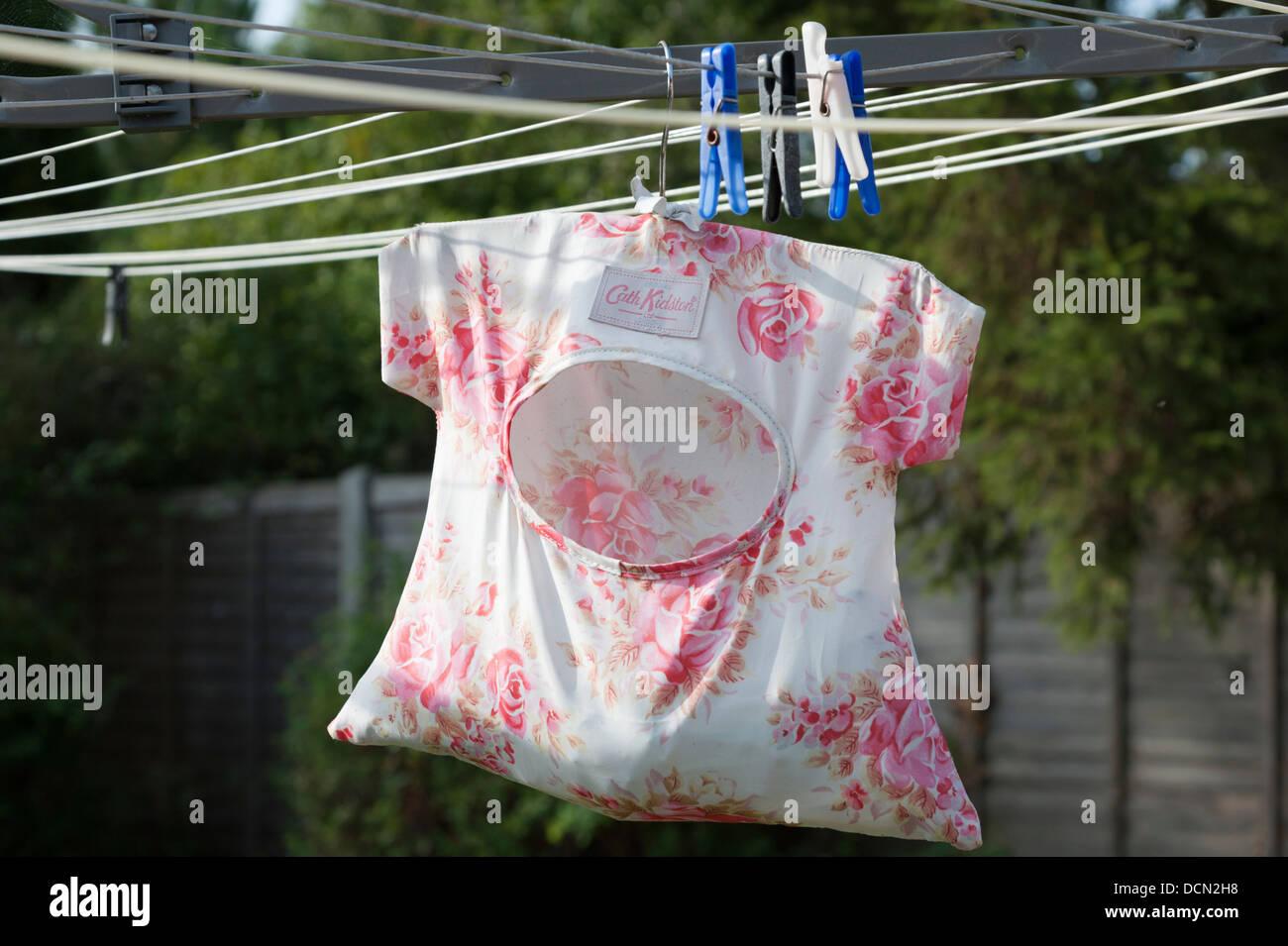 Cath Kidson peg bag hanging on a washing line - Stock Image