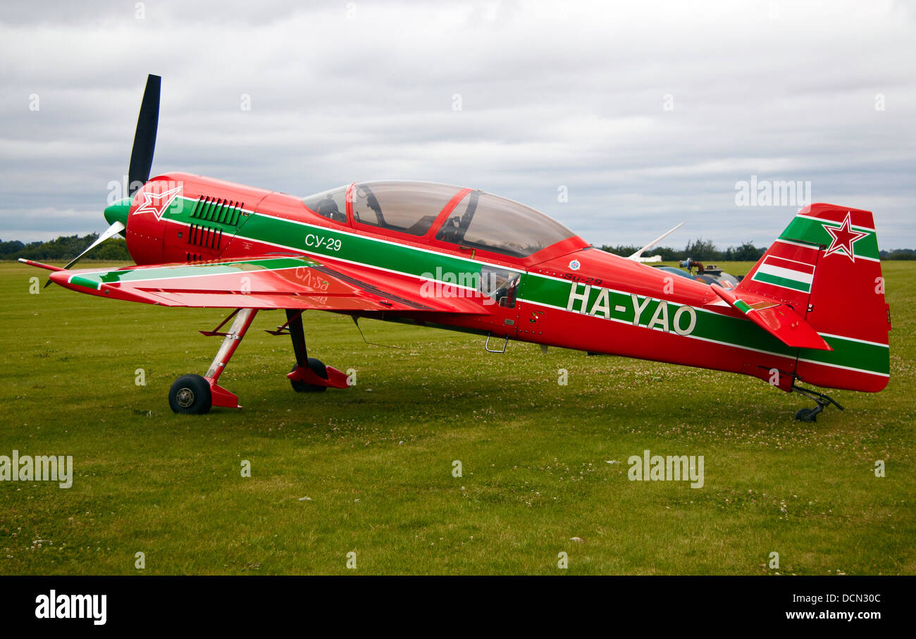 Red and green Sukhoi Su-29. Aerobatic plane - 2 seater, Wings and Wheels Show, near Norwich, Norfolk, England, UK. - Stock Image