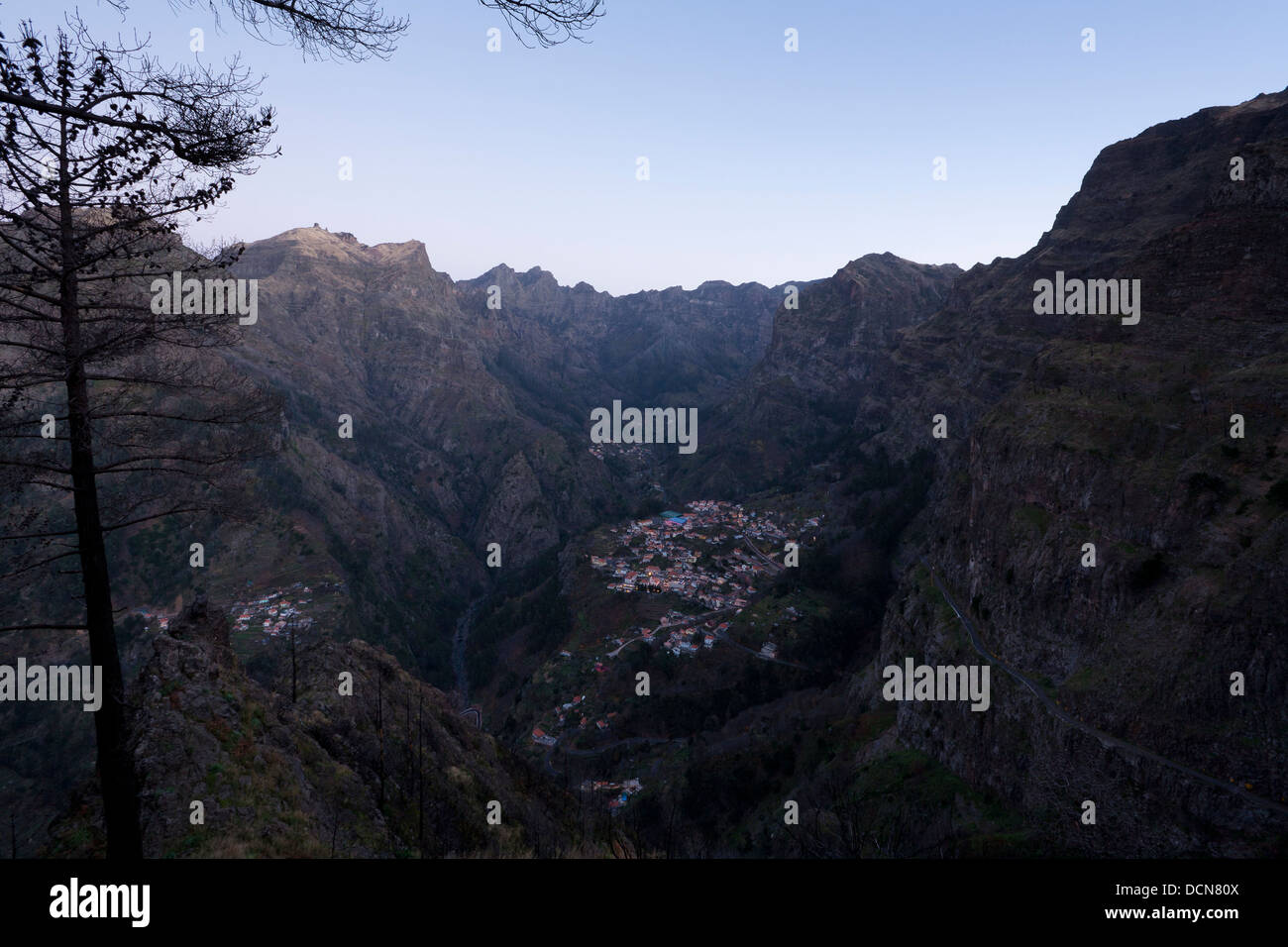 The village of Curral das Freiras as seen from the the path towards the viewpoint at Eira do Serrado. - Stock Image