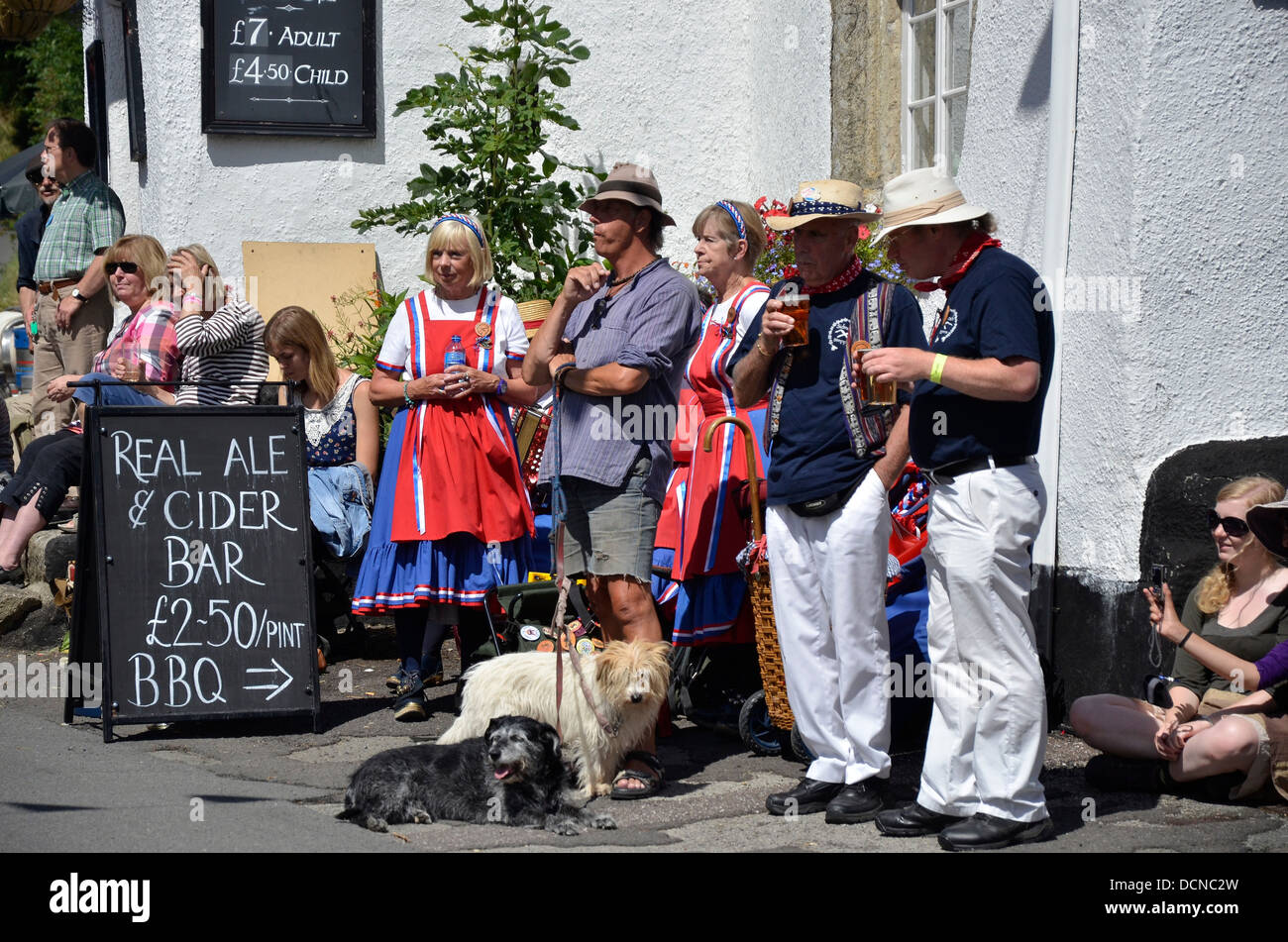 People drinking outside the Kings Arms pub, South Zeal, Dartmoor, Devon, during the 2013 Dartmoor Folk Festival - Stock Image