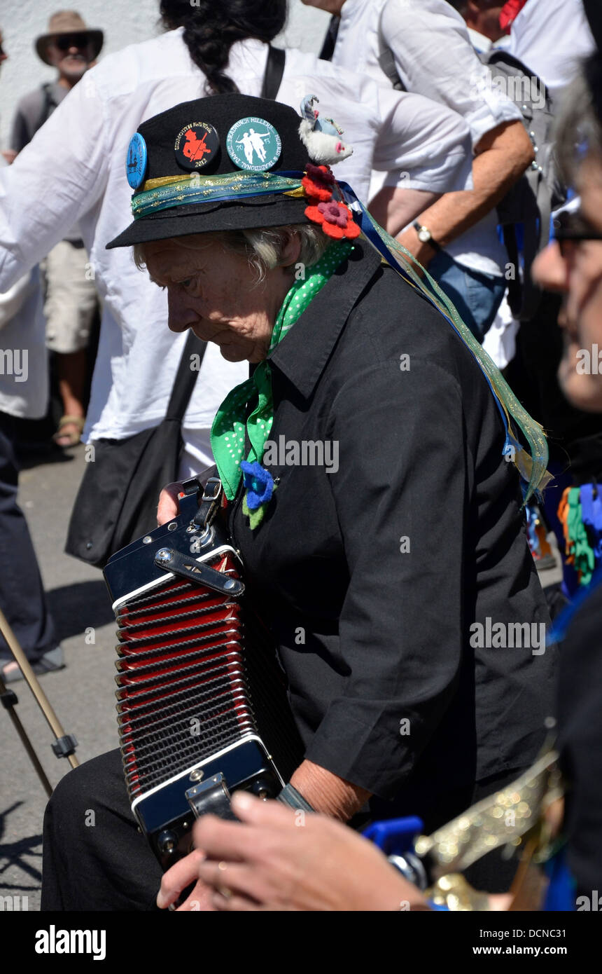 Lady playing the accordion for Morris Dancers at the 2013 Dartmoor Folk Festival, South Zeal, Dartmoor, Devon, England - Stock Image