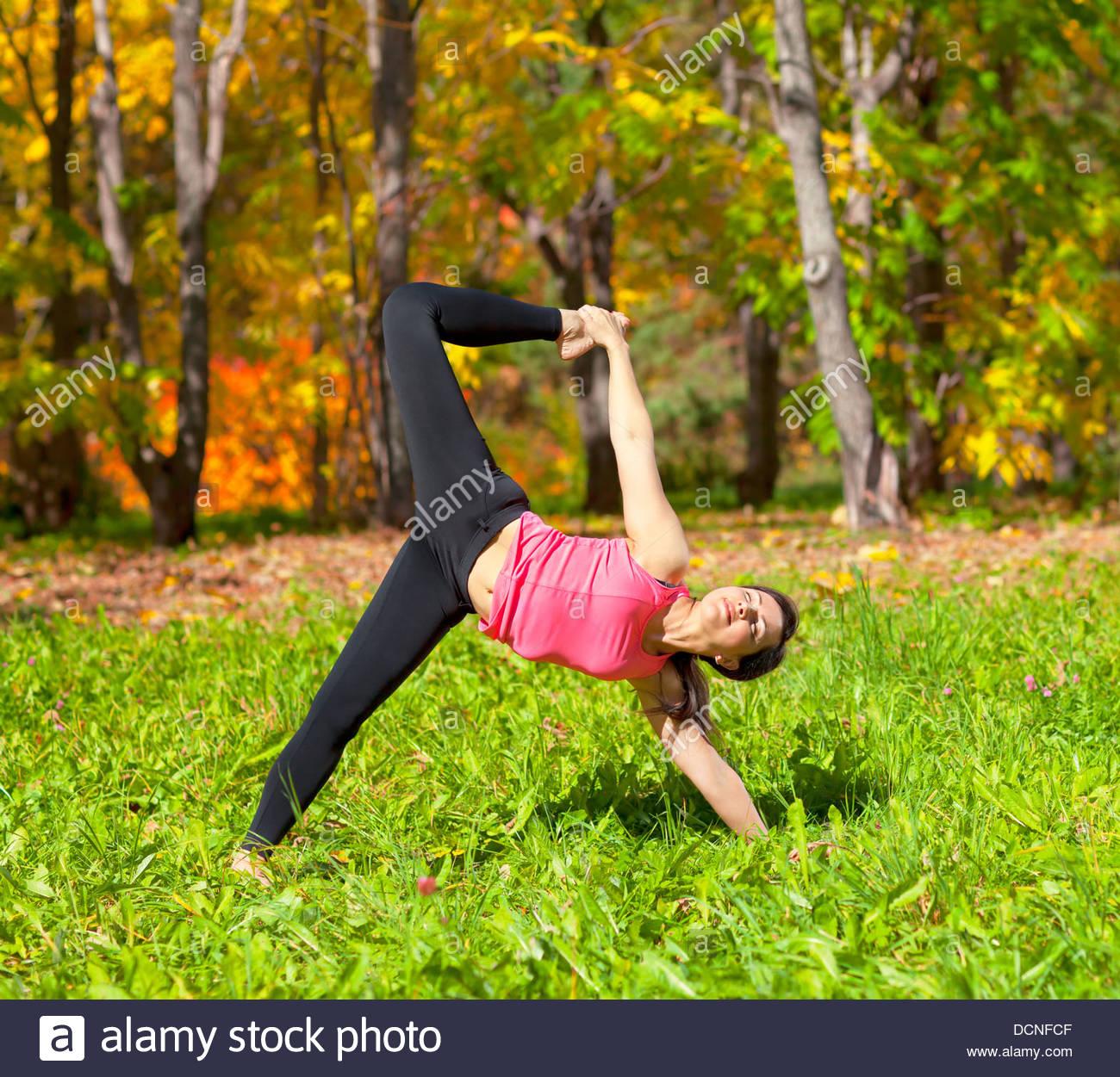 Yoga Ardha Chandra chapasana pose Stock Photo