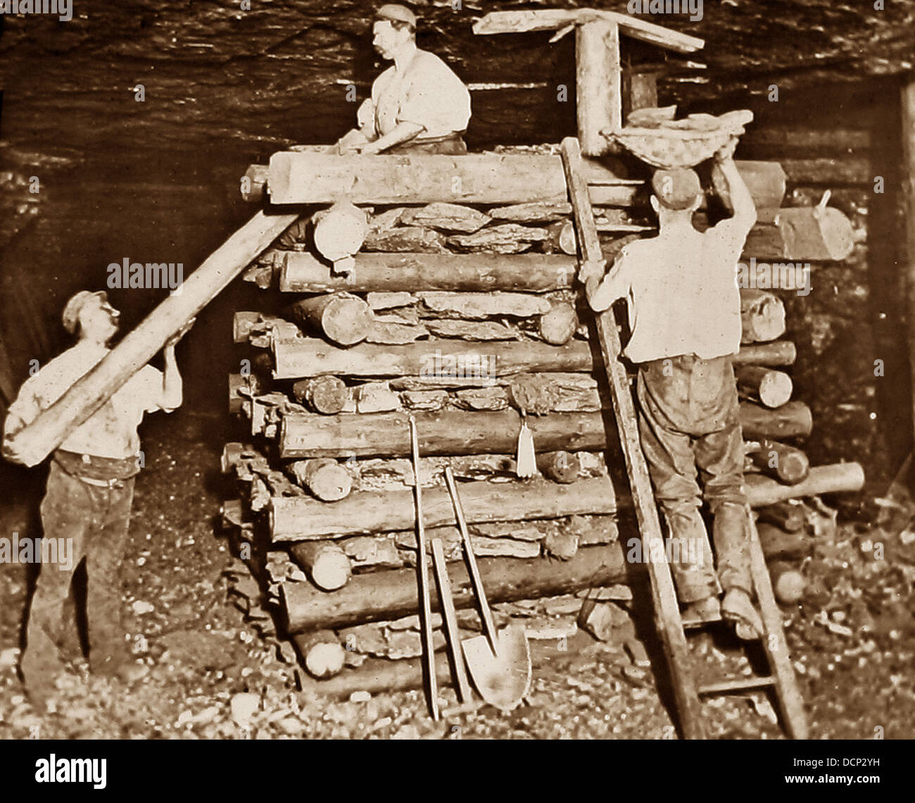 Miners building a cog Victorian period - Stock Image