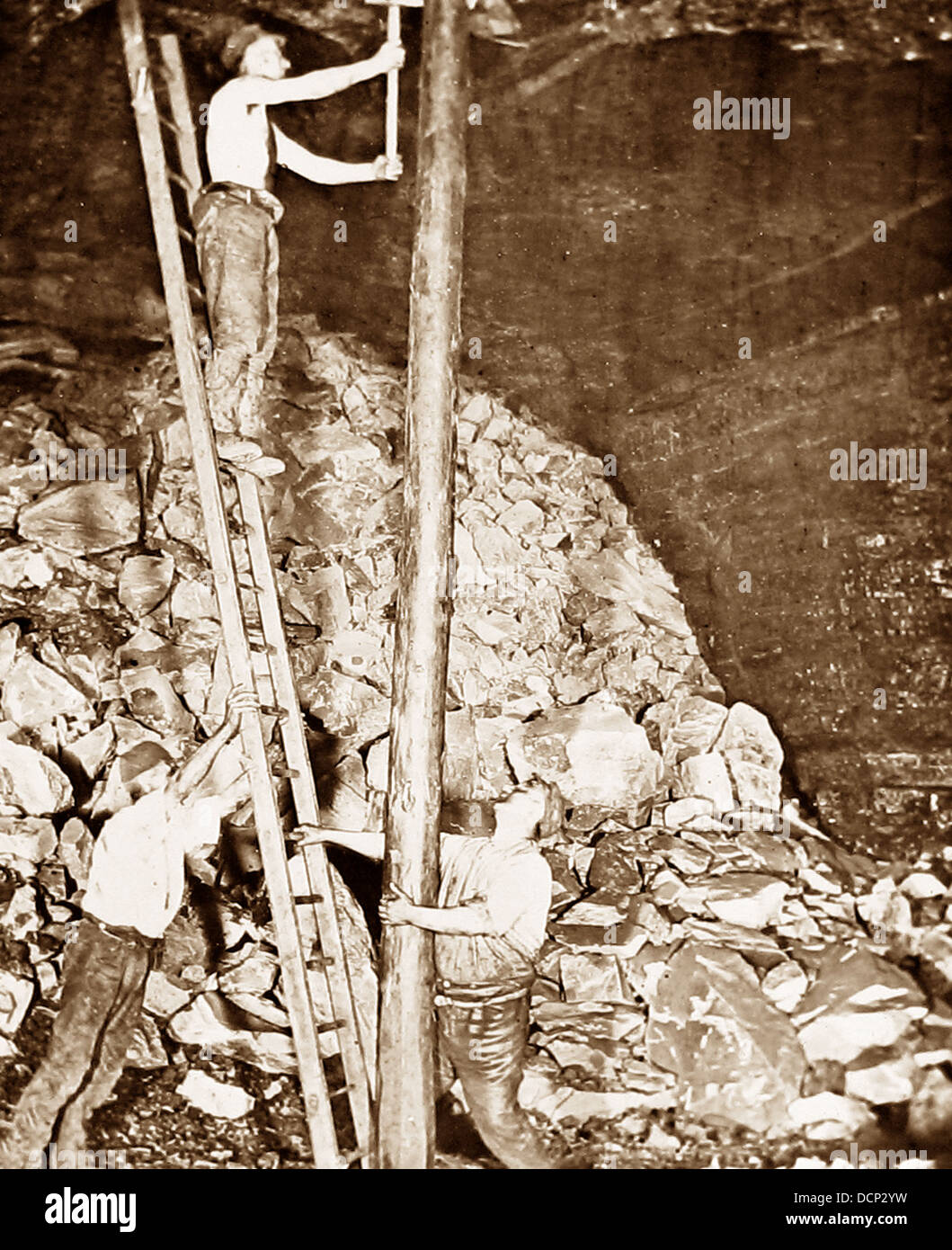 Miners fitting long pit props Victorian period - Stock Image