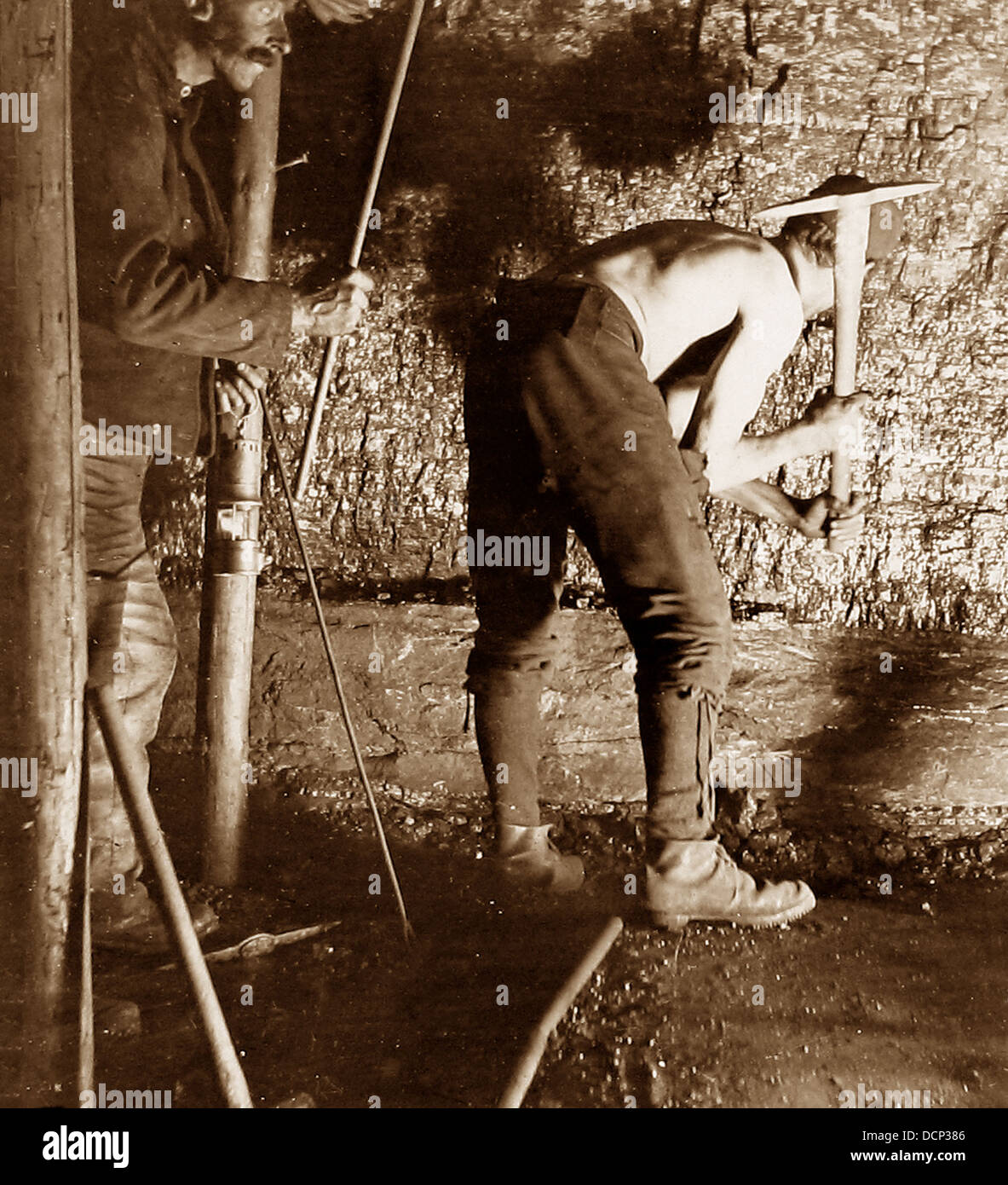 Coal miner starting to make a hole Victorian period - Stock Image