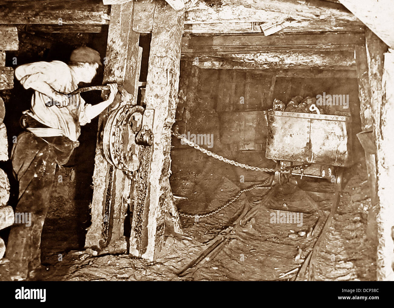 Coal miner using self-acting incline haulage early 1900s - Stock Image