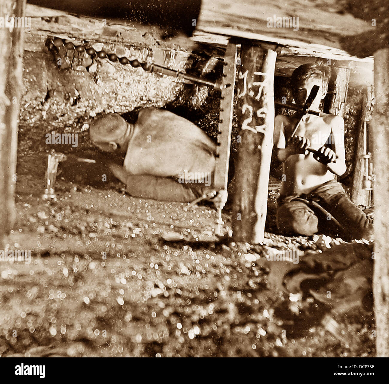 Miners drilling holes in a two foot seam early 1900s - Stock Image