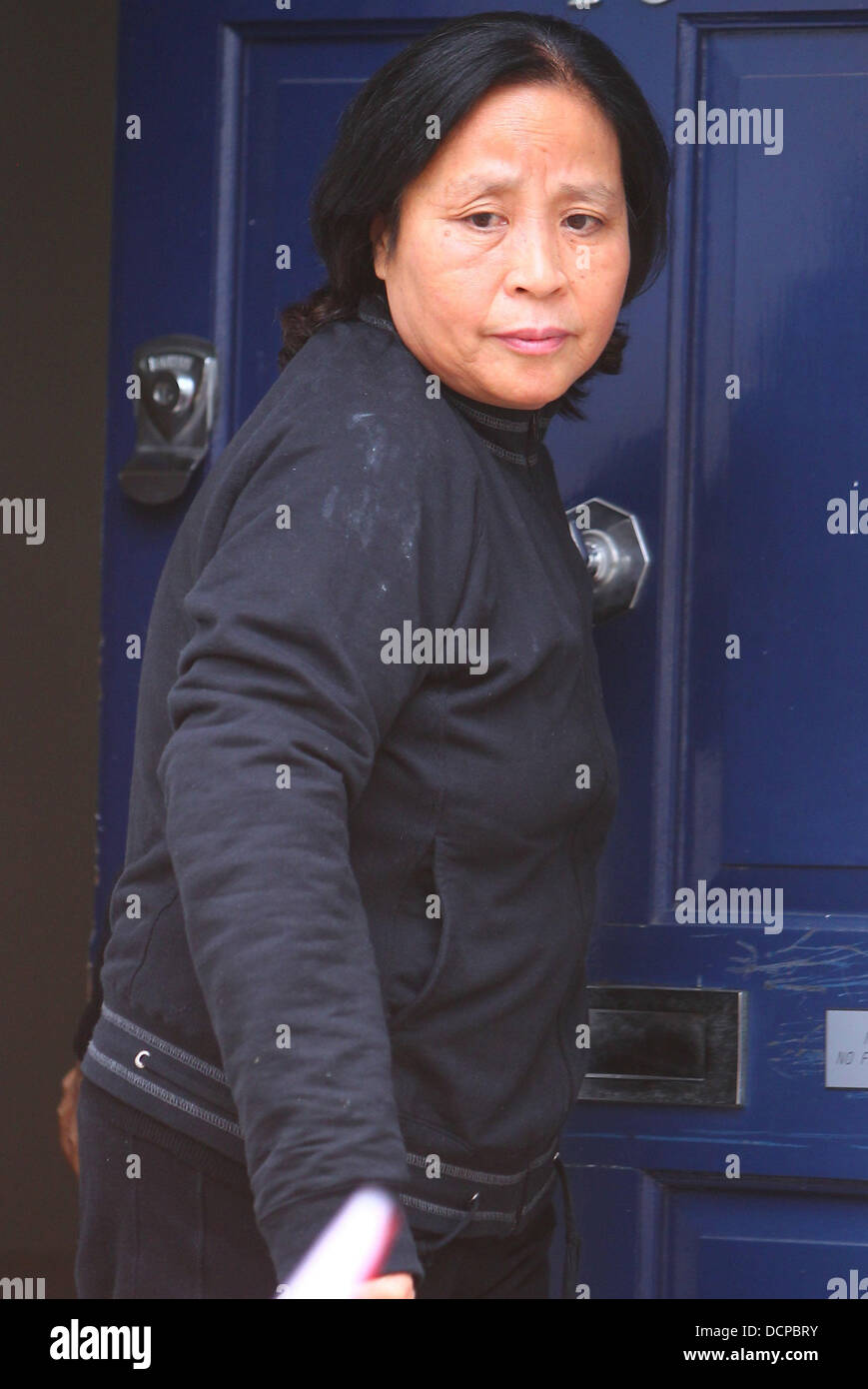 The Mother Of Tinglan Hong Outside Her Daughter S House The Chinese Stock Photo Alamy
