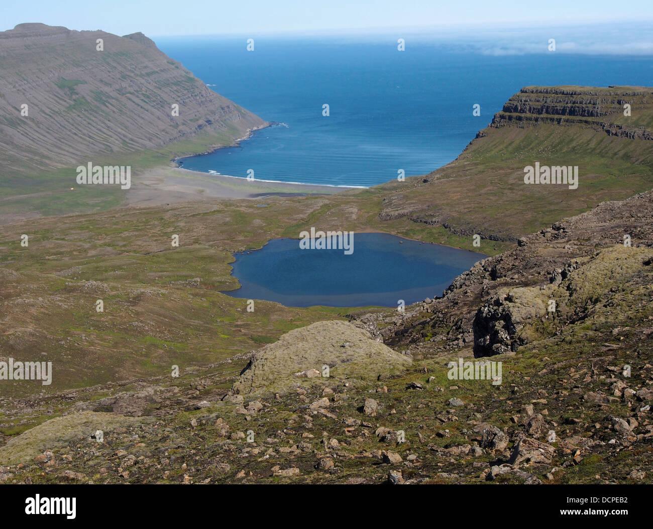 Sandvík from pass, Gerpisskarð, Iceland - Stock Image