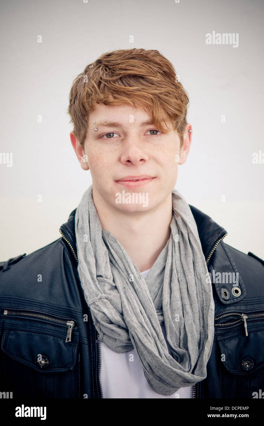 Portrait of real young man on simple background - Stock Image