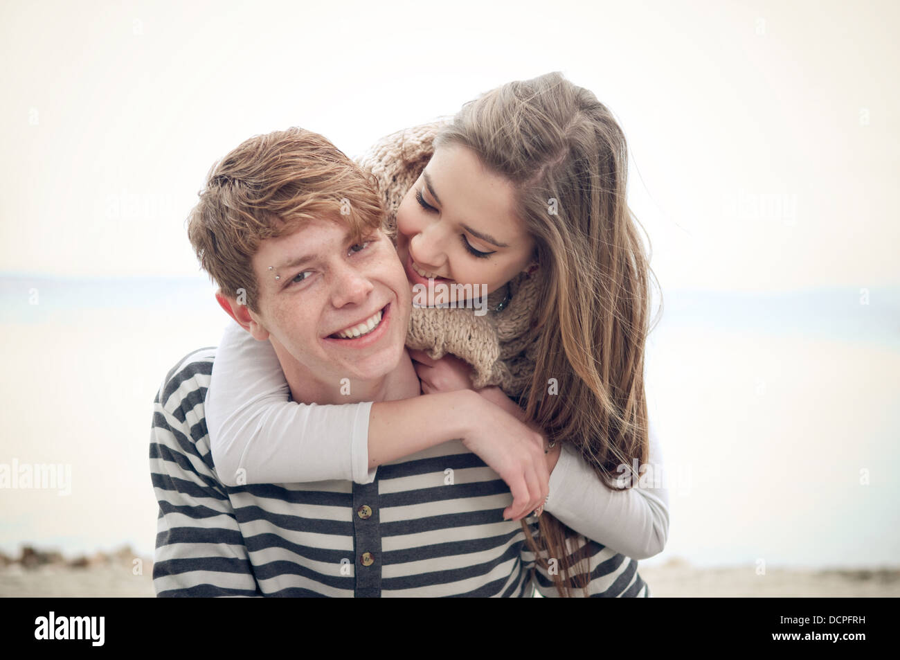 Happy teenage couple in love - Stock Image