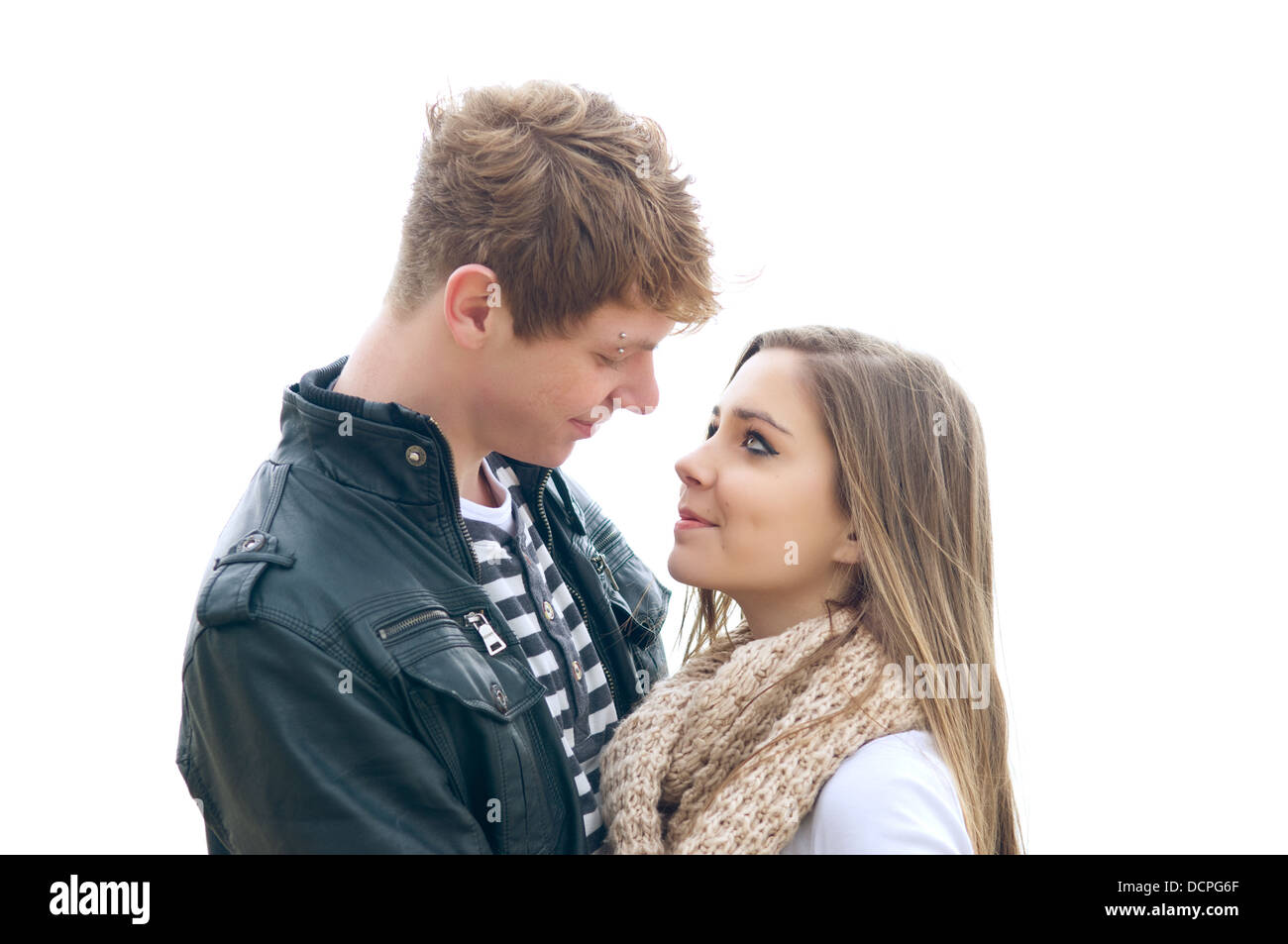 Teenage couple in love. White background - Stock Image
