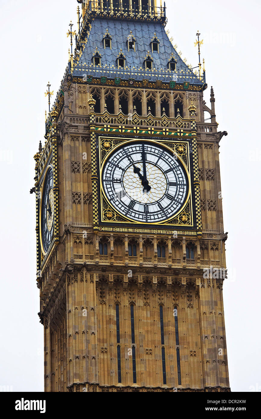 The dial of The Great Clock of Westminster shows the time as 11am as Big Ben chimes to mark Armistice Day (Remembrance Stock Photo
