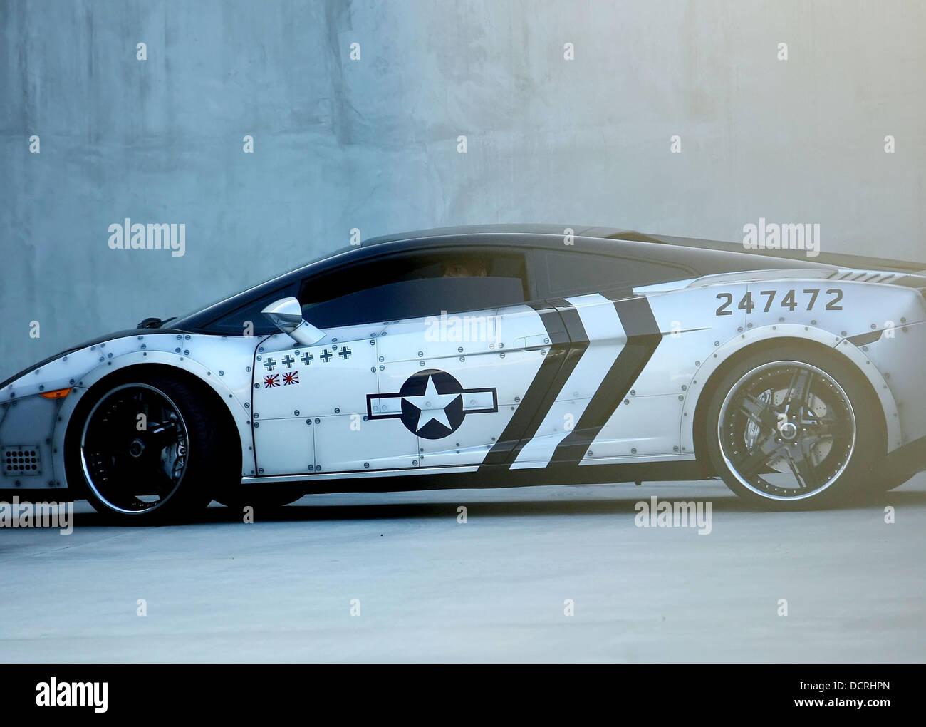 Chris Brown Waits In His Customized Lamborghini Gallardo For His