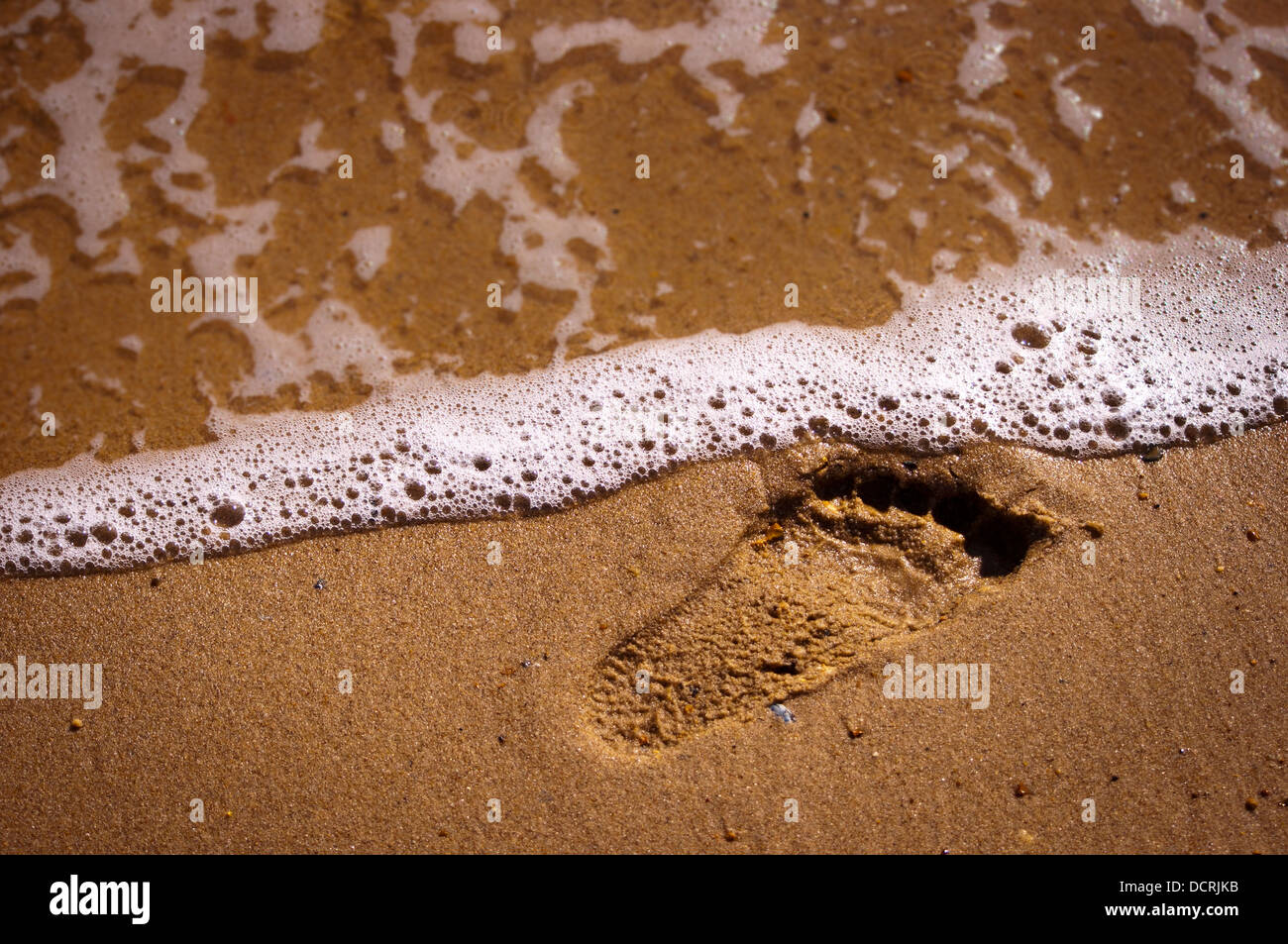 bare foot print marks on Norfolk sand Beach - Stock Image