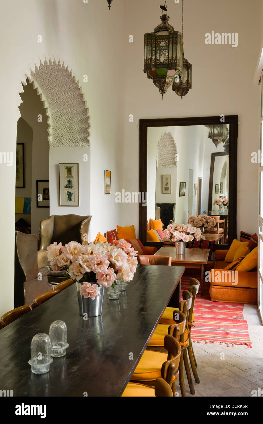 Dining Room With Moroccan Style Lanterns And Orange And Yellow Stock