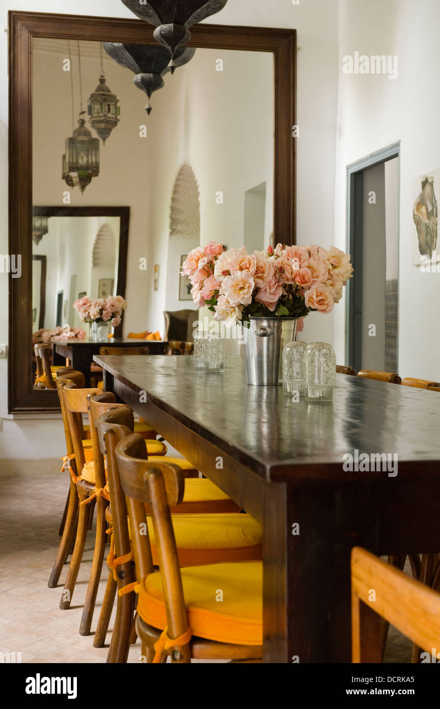 Dining Room With Moroccan Style Mirror And Chair Seats Upholstered