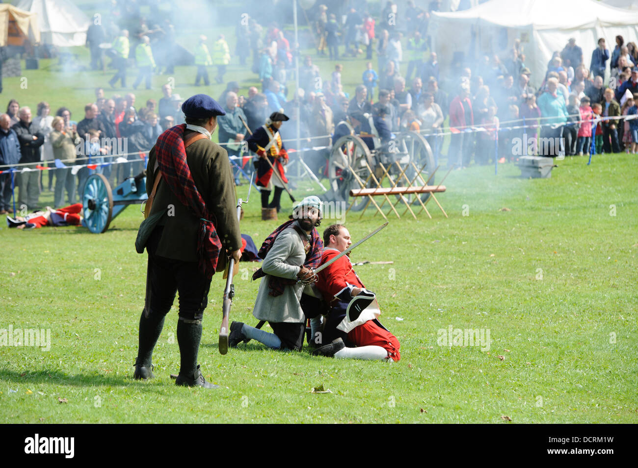 Redcoats battle the Jacobites during a re-enactment at Scotland's Festival of History at Chatelherault South - Stock Image
