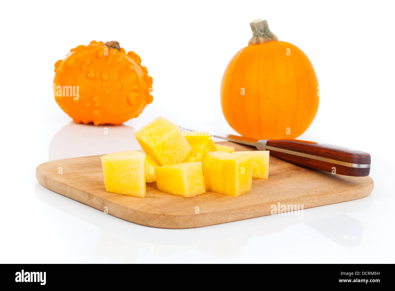 sliced pumpkin, ready for cooking. isolated on white Stock Photo