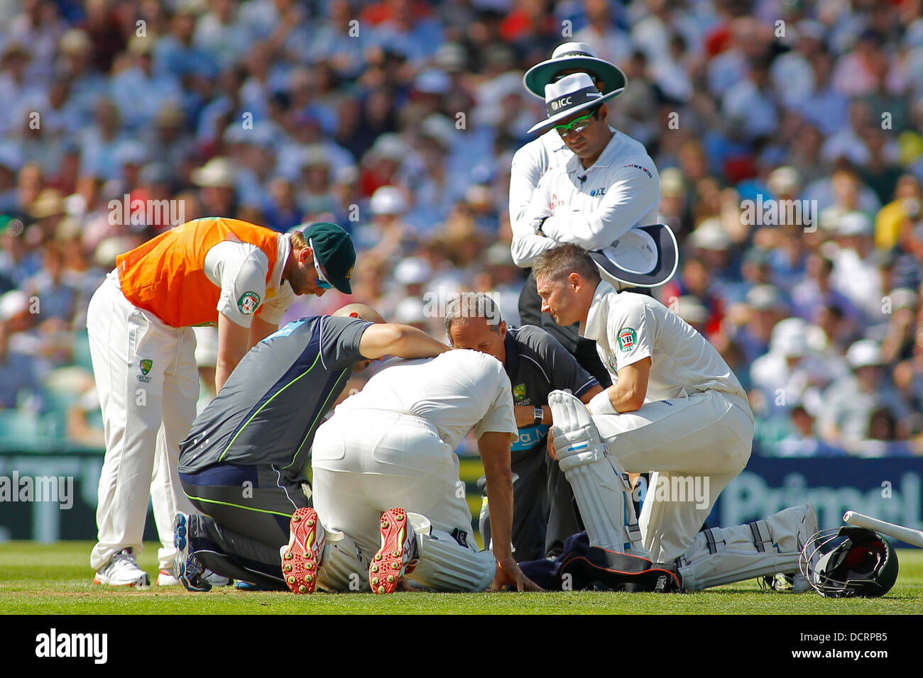 London, UK. 21st Aug, 2013. Shane Watson gets some medical attention after being hit on the head during day one - Stock Image