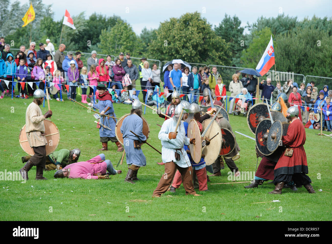 A Viking skirmish during a re-enactment at Scotland's Festival of History at Chatelherault Country Park South - Stock Image