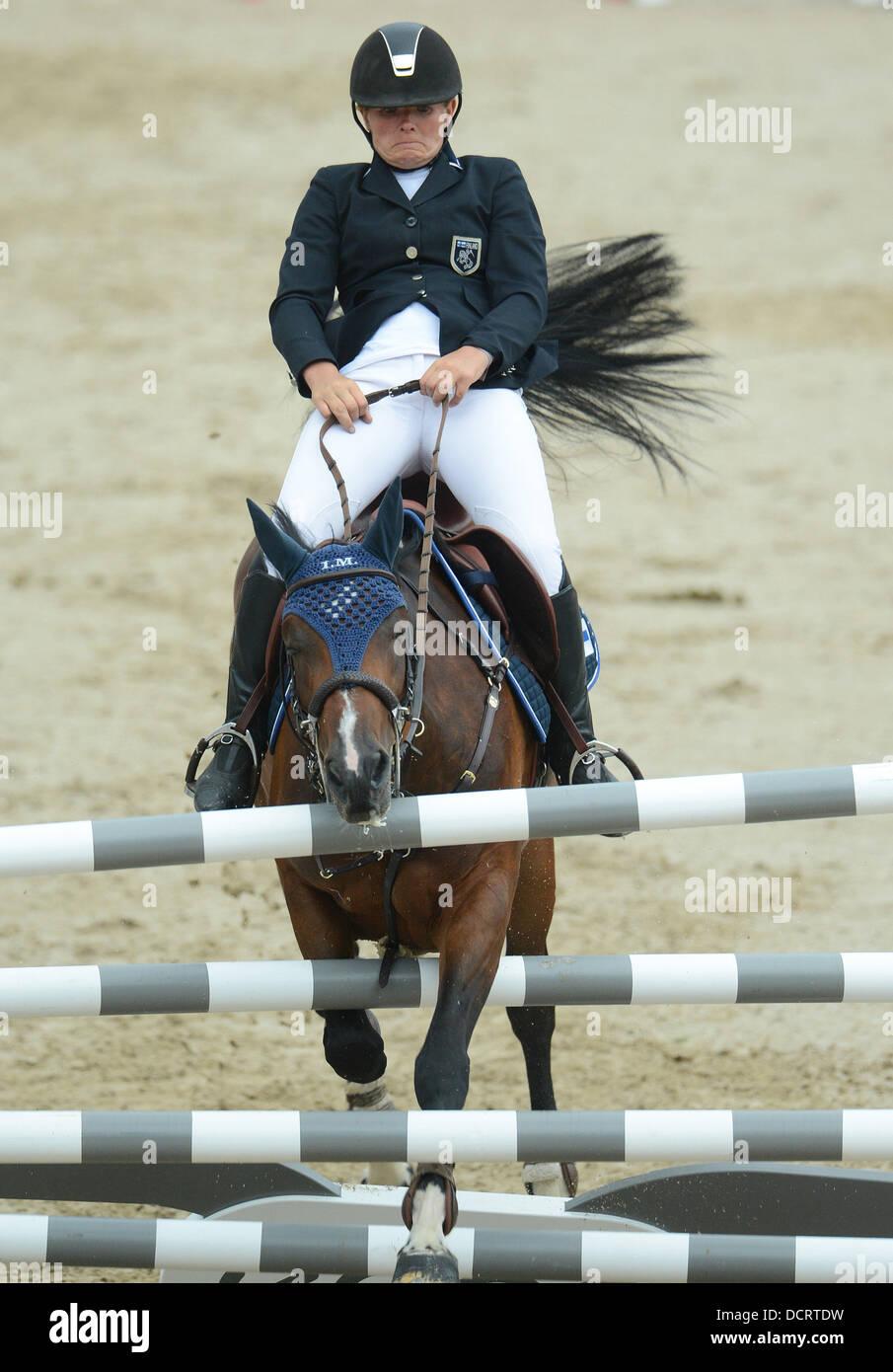 Herning, Denmark. 21st Aug, 2013. Finnish show jumper Satu Liukkonen and her horse Celestine knock down an obstacle - Stock Image