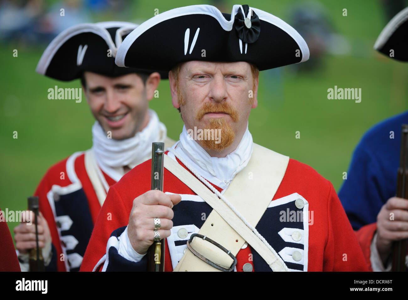 Redcoats on parade during a re-enactment at Scotland's Festival of History at Chatelherault Country Park South - Stock Image