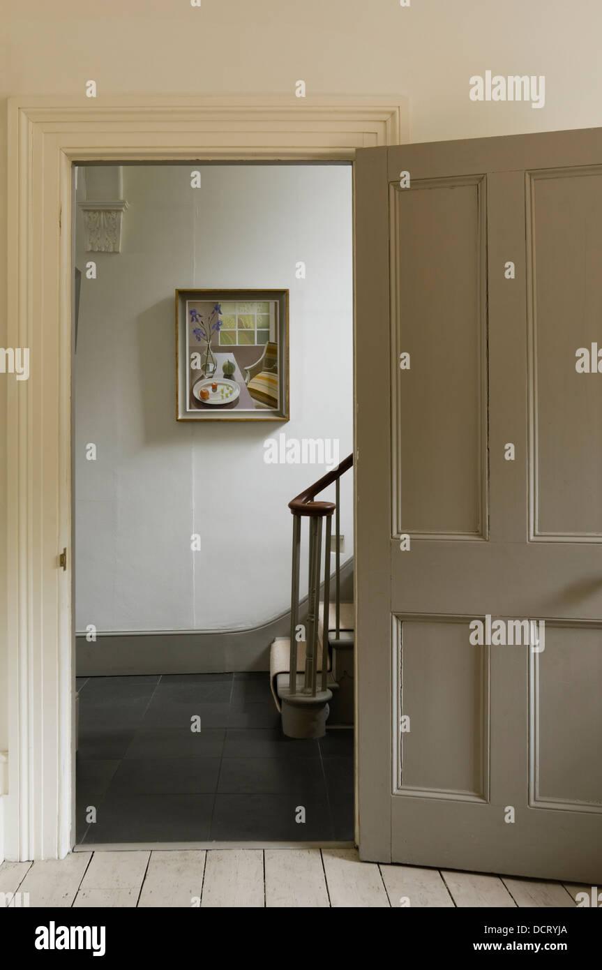 Open doorway to hallway landing of Georgian townhouse interior - Stock Image